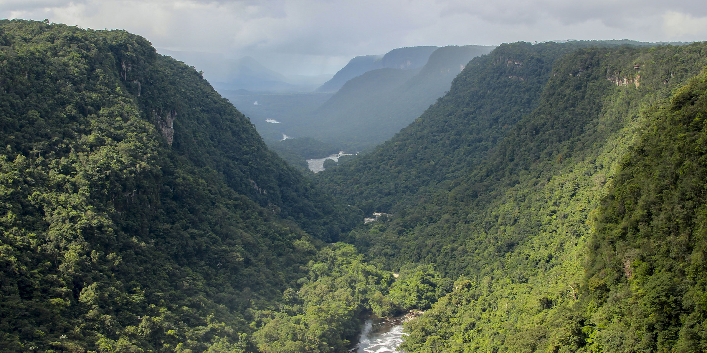 The Potaro River flows between table-top mountains in Kaieteur national park, Guyana
